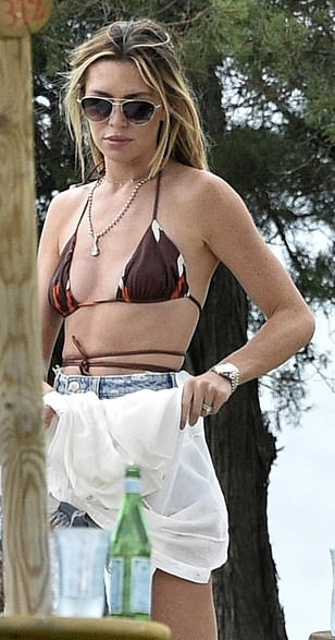 Abbey Clancy wearing Skimpy brown printed bikini bottom