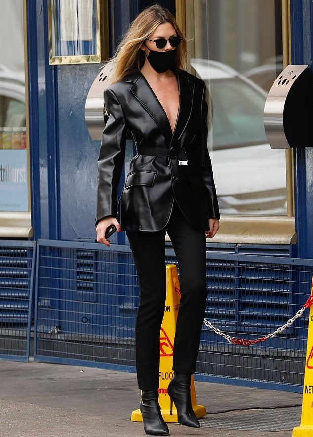 Abbey Clancy donning pointy black boots with high heel