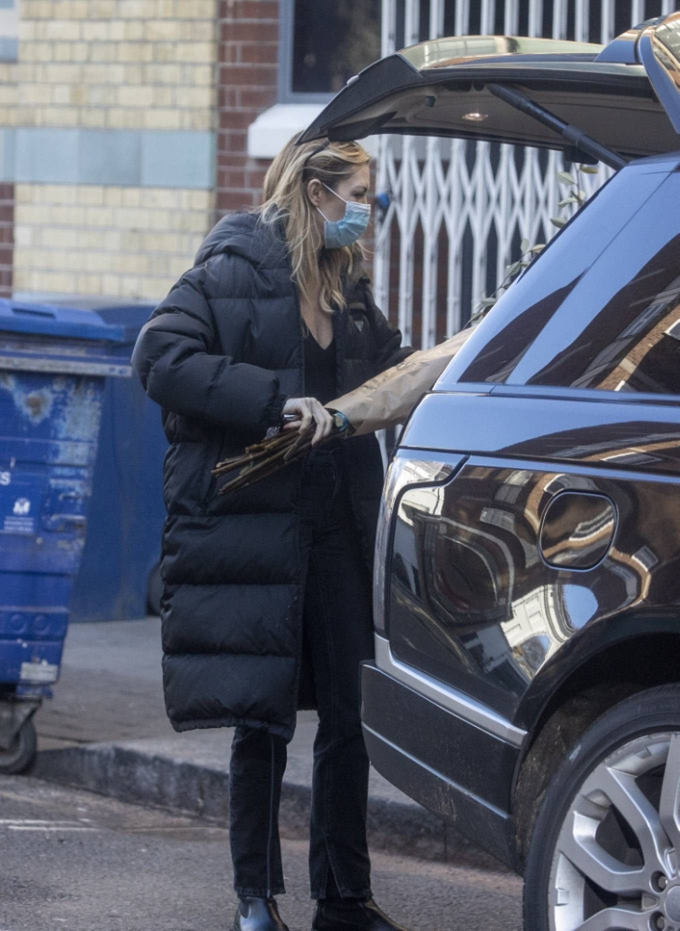 Abbey Clancy donning square black leather ankle boots with platform heels