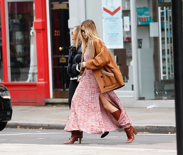Abbey Clancy donning pointy brown leather ankle boots with high heel