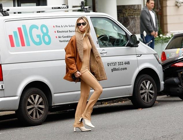 Abbey Clancy wearing a nude sweatshirt