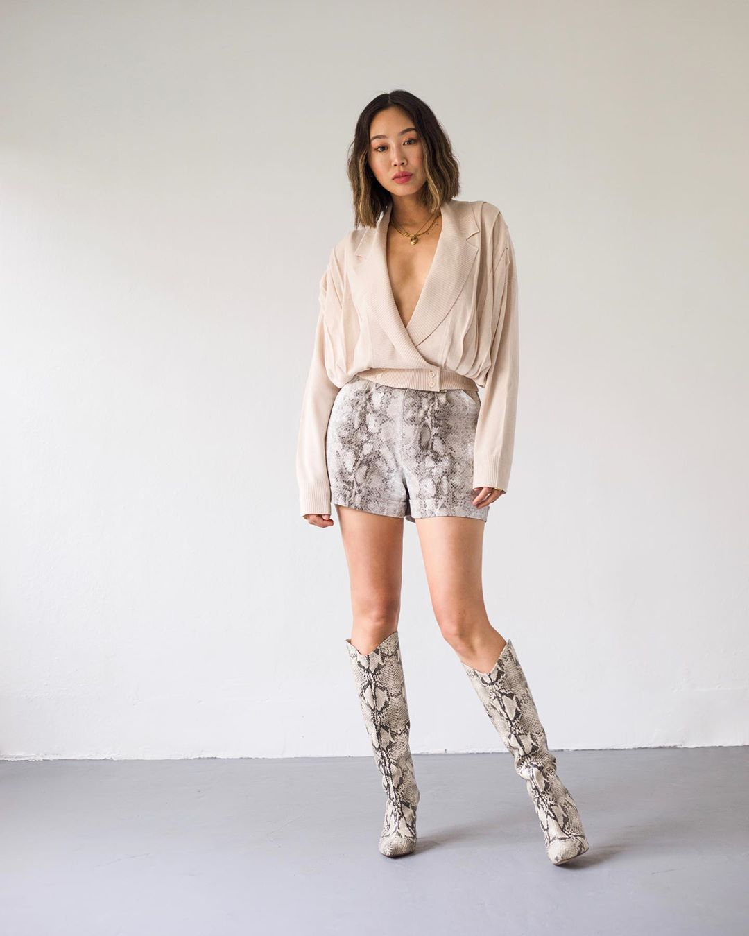 Aimee Song wearing narrow grey cream mid calf boots with high heel