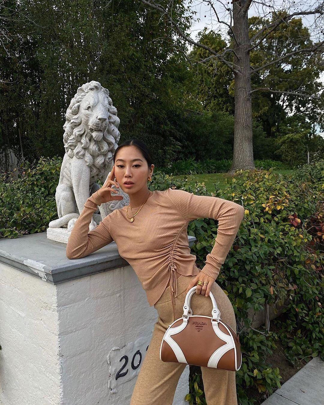 Aimee Song wearing Comfortable metallic light gold high rise pants
