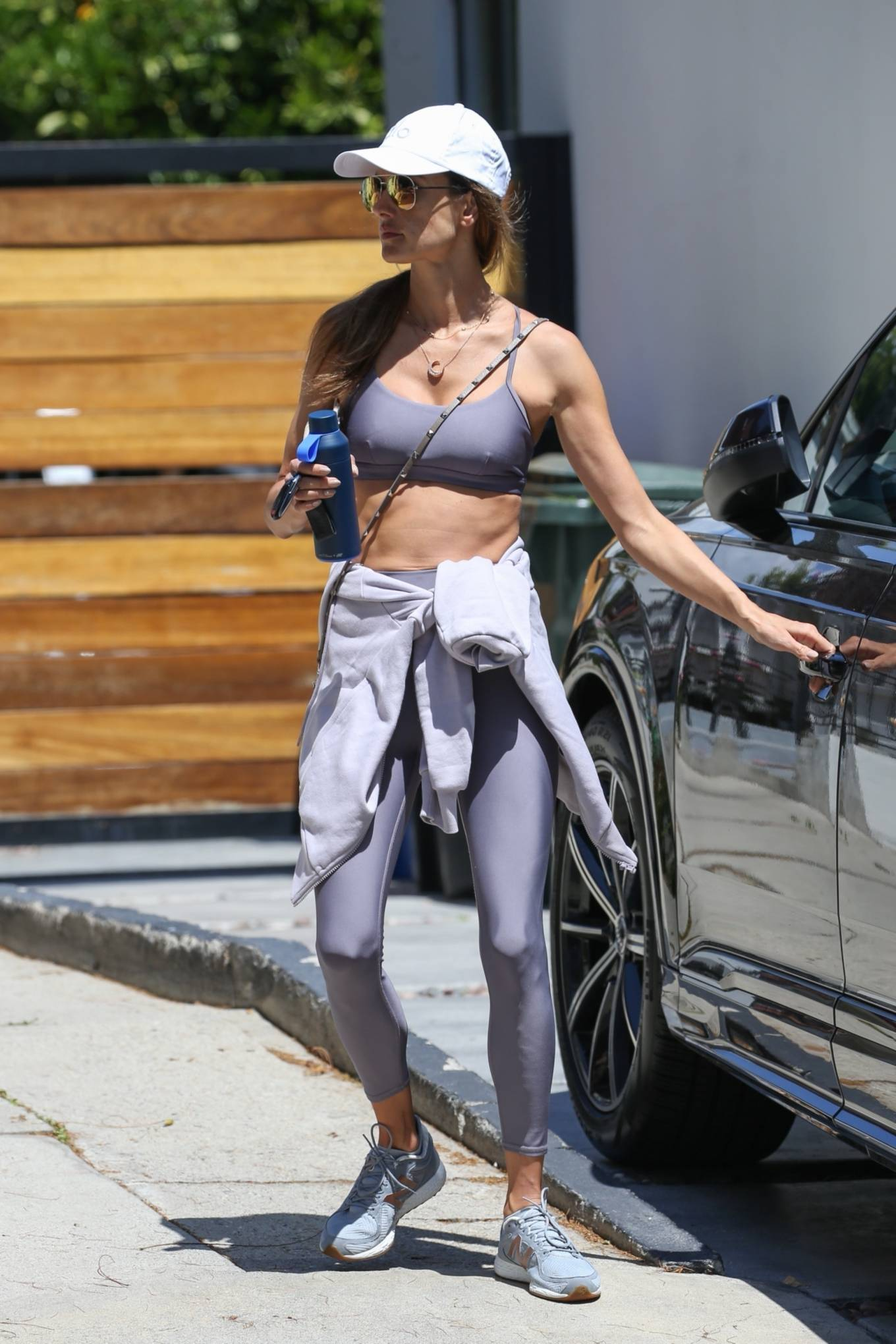 Alessandra Ambrosio rocking a fitted lilac sports bra with a stretch fabric, a scoop neck and spaghetti straps