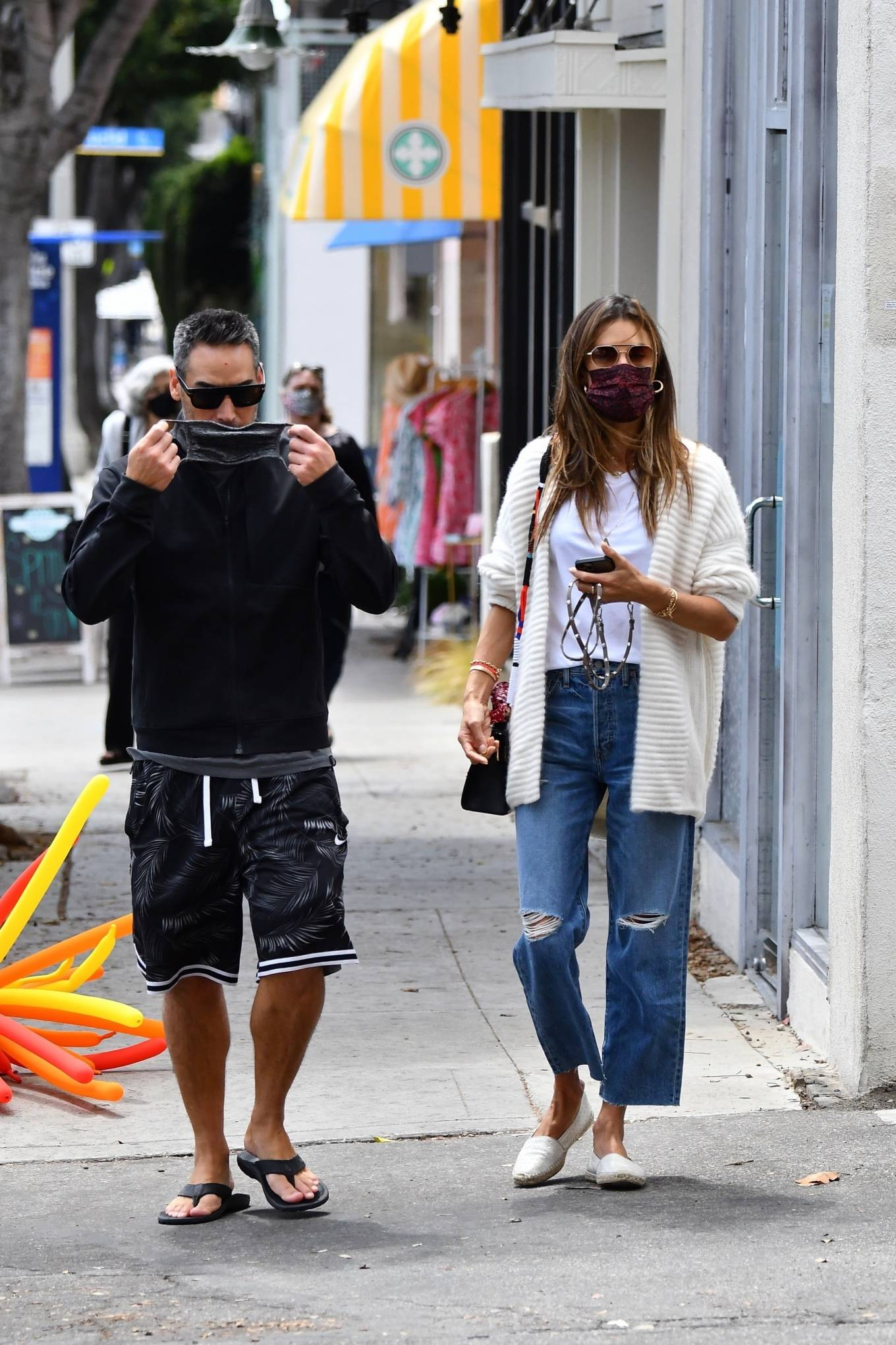 Alessandra Ambrosio, white  pumps, leather, Saint Laurent  pumps, off white Maje cardigan, black sling bag, round, slip on, metal detailing, white tank top, brown Vehla sunglasses, blue Etica Denim jeans