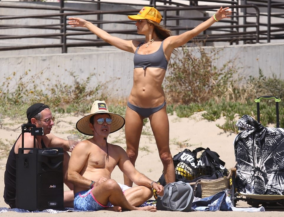 Alessandra Ambrosio wearing a grey nylon bikini top with knotted, a scoop neck and straps
