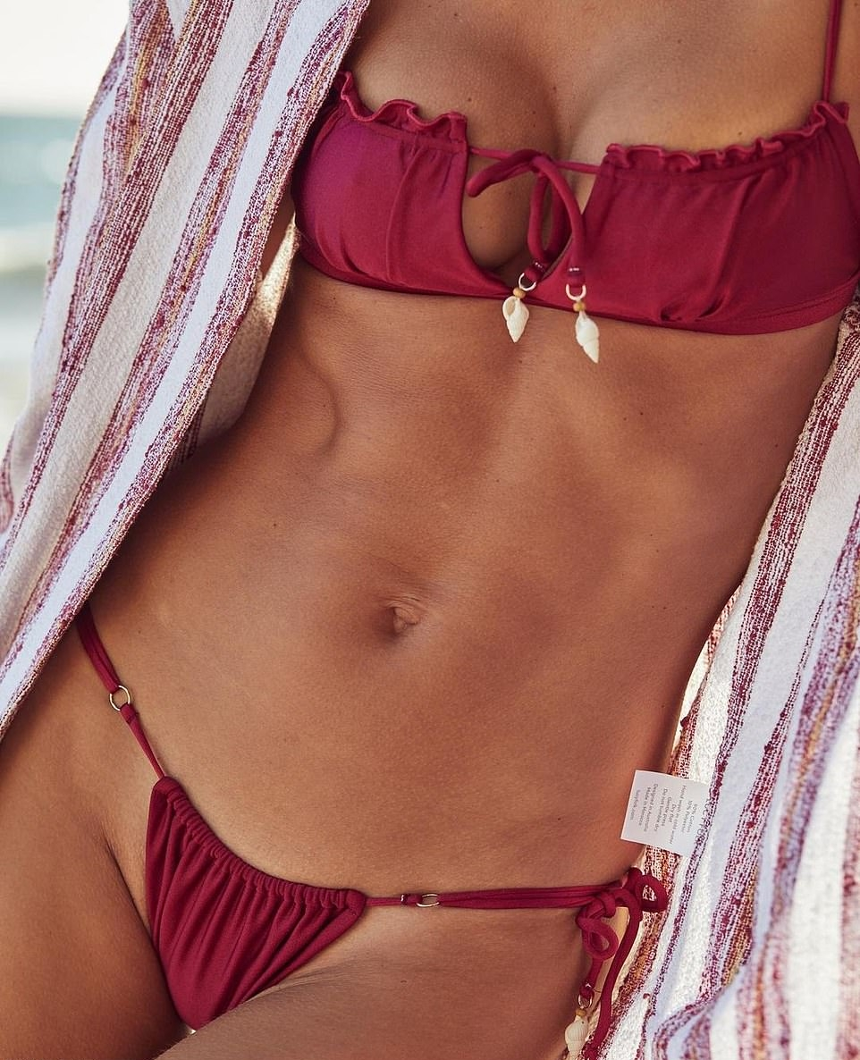 Alessandra Ambrosio rocking a deep V-neck dusty rose pink bikini top with Embellish with sea shell ornaments and spaghetti straps