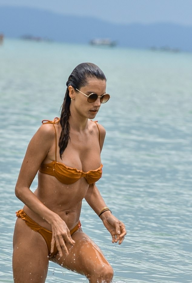Alessandra Ambrosio wearing a plunging nude bikini top with two ties at the shoulder