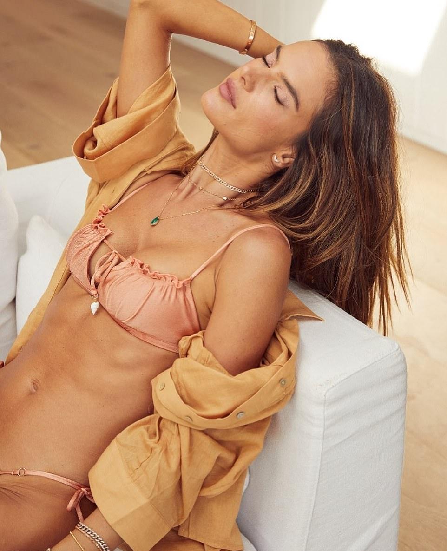Alessandra Ambrosio donning a deep V-neck peach bikini top with Embellish with sea shell ornaments and spaghetti straps