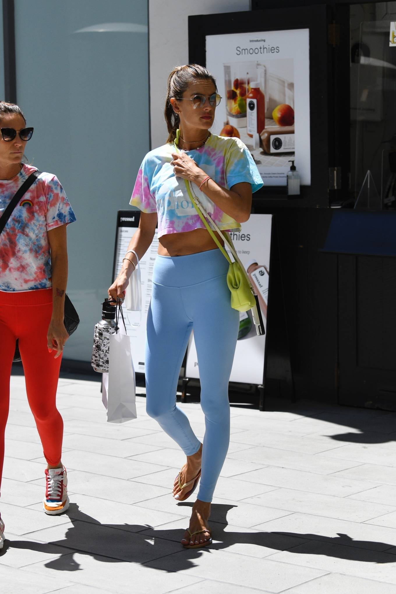 Alessandra Ambrosio rocking fitted light blue ribbed workout leggings with high waist with a stretch fabric material