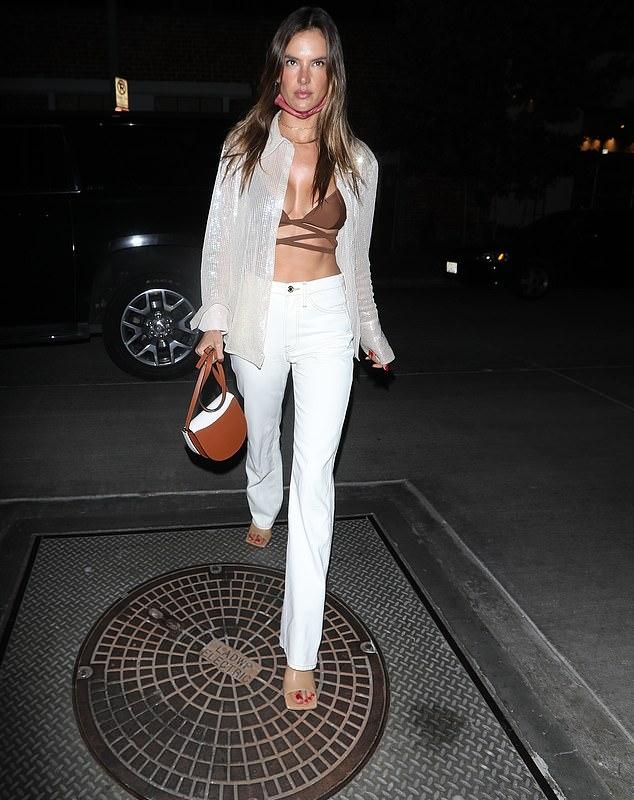 Alessandra Ambrosio wearing round beige sandals