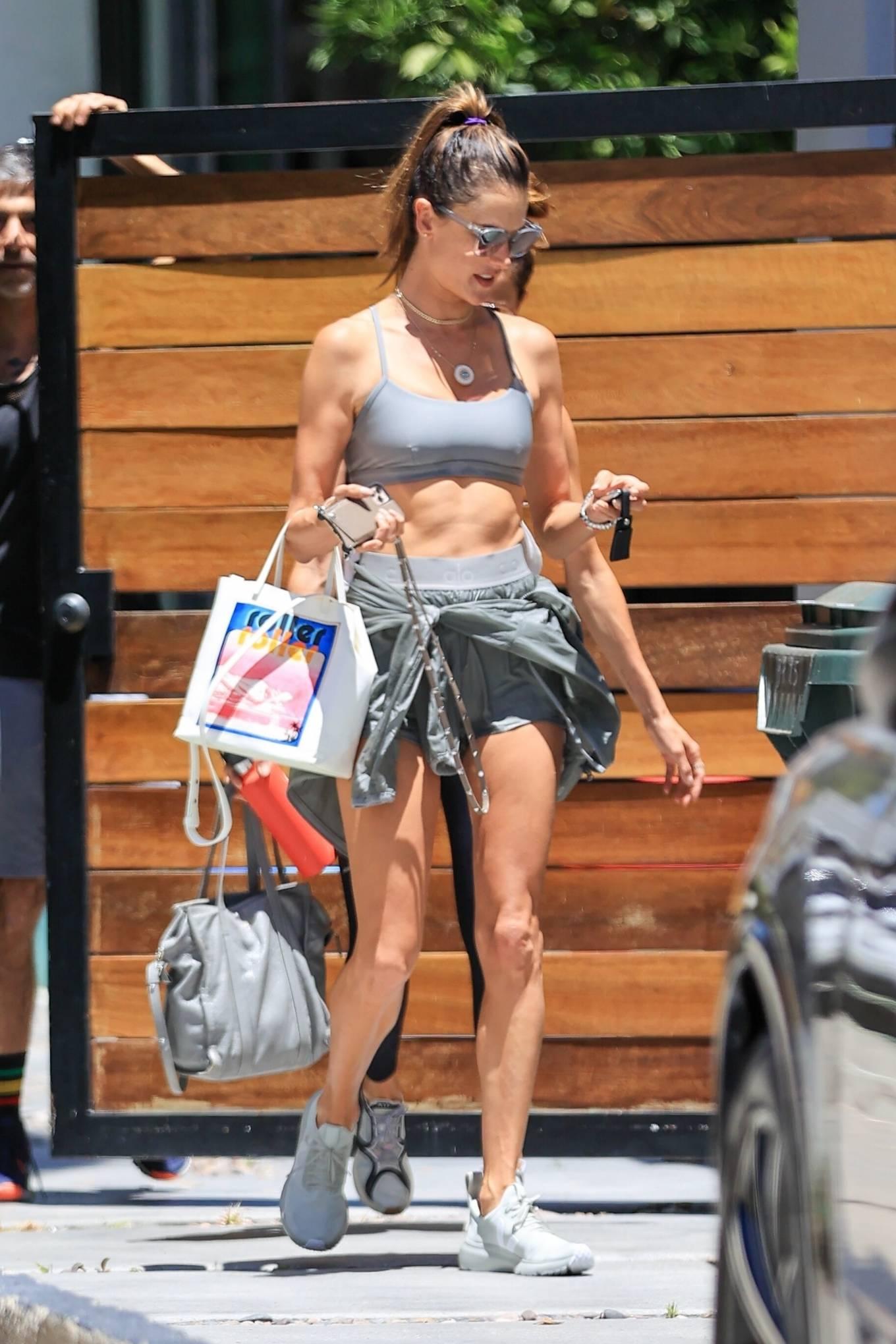 Alessandra Ambrosio rocking round white off white slip on sneakers by Rick Owens