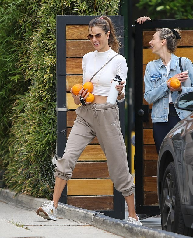 Alessandra Ambrosio rocking baggy Taupe drawstring sweatpants with elastic hem with side pockets and a fleece material