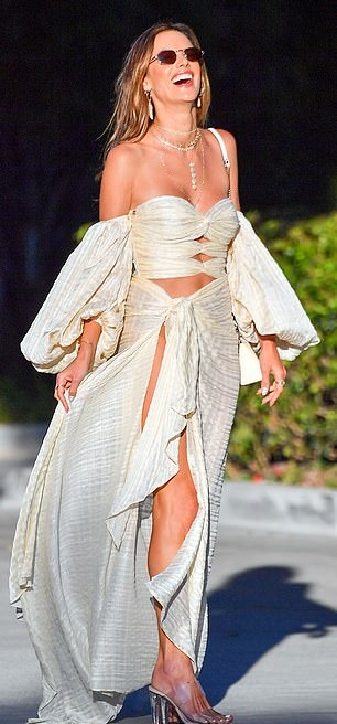 Alessandra Ambrosio wearing round transparent PVC slip on sandals with high heel