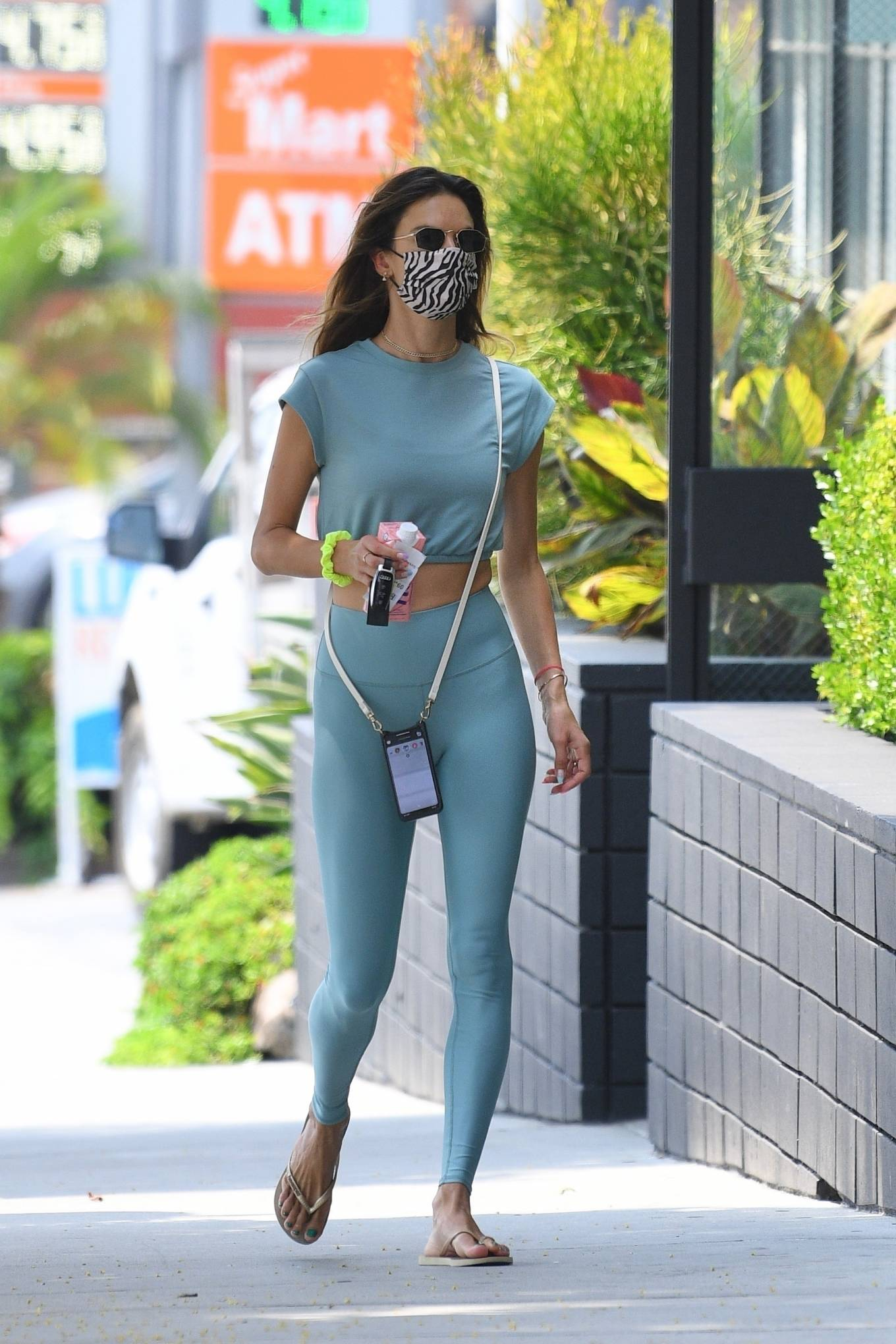 Alessandra Ambrosio wearing a relaxed fit bi color top with a cotton material, cap sleeves, a high neck and elastic hem
