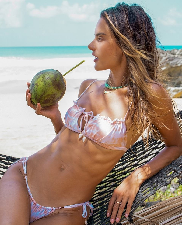 Alessandra Ambrosio donning fitted bi color high waist bikini bottom