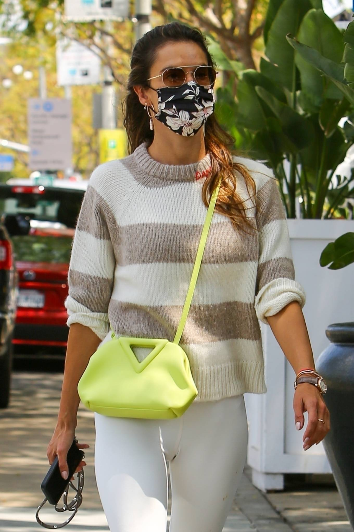 Alessandra Ambrosio donning round white leather lace-up sneakers with flat heel