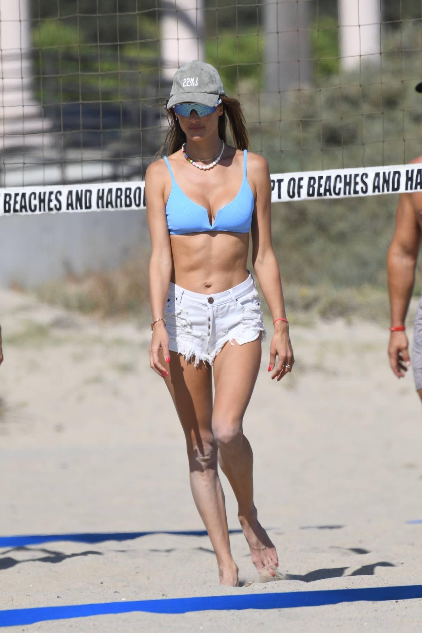 Alessandra Ambrosio donning a skimpy blue bikini top with a scoop neck and spaghetti straps