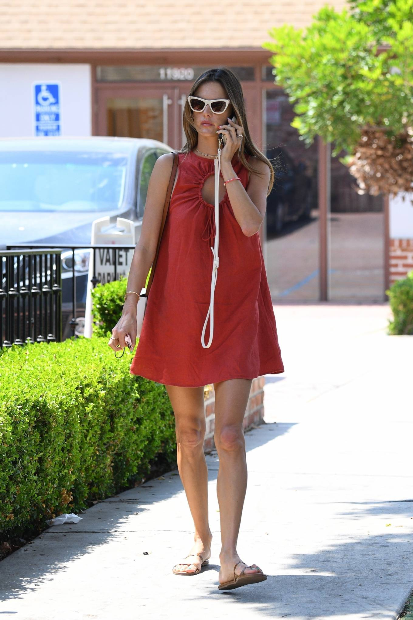 Alessandra Ambrosio wearing round brown open toe sandals by tkees