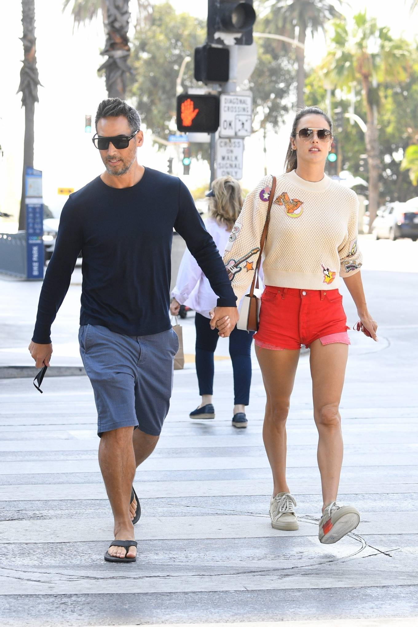Alessandra Ambrosio donning round beige lace-up sneakers by goat