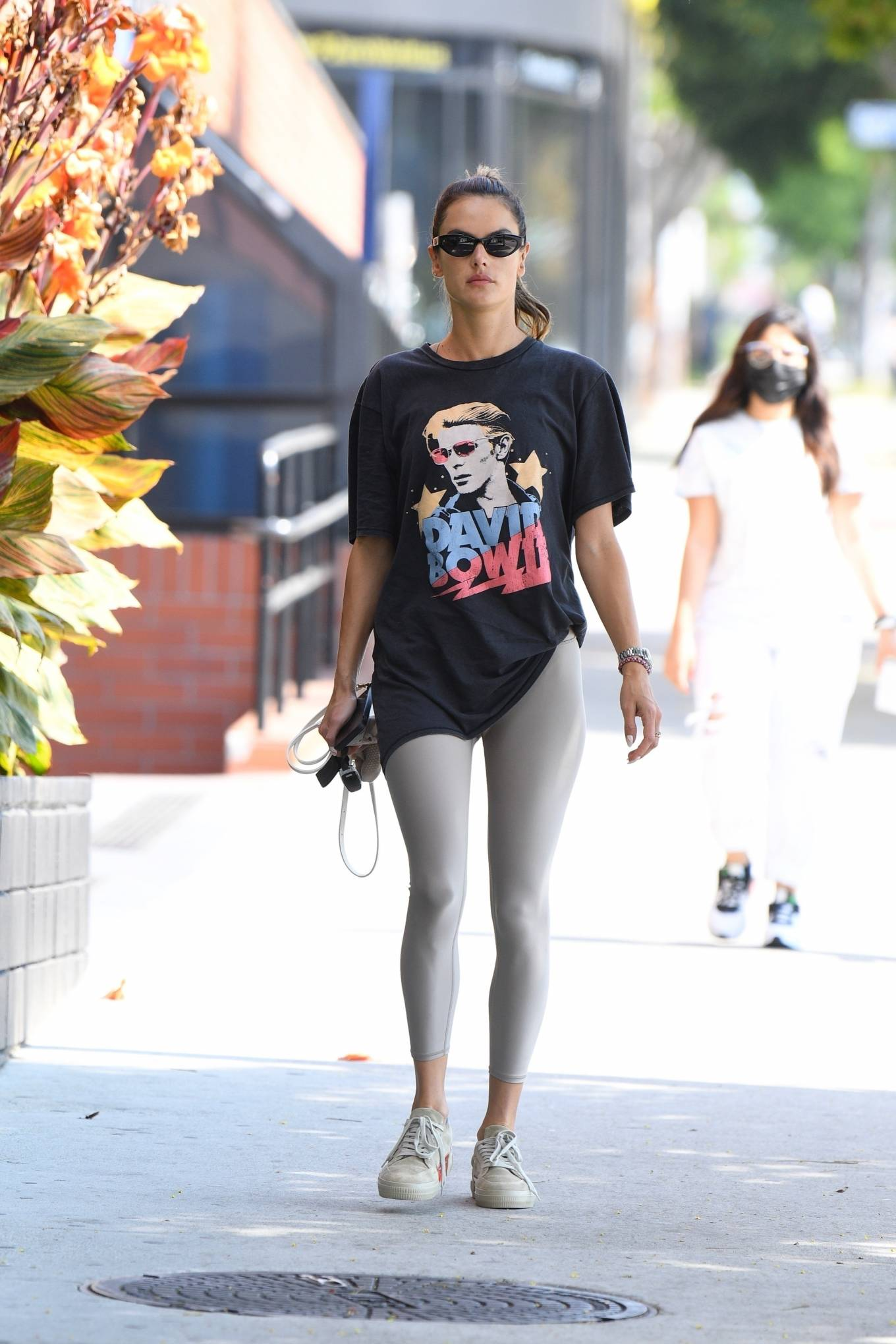 Alessandra Ambrosio wearing brand logo grey lace-up sneakers by goat