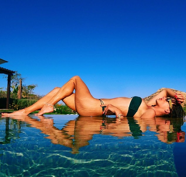 Alessandra Ambrosio rocking fitted dark green high waist bikini bottom
