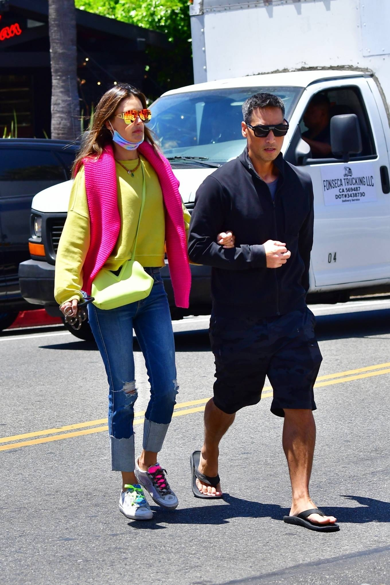 Alessandra Ambrosio wearing round multicolor lace-up sneakers