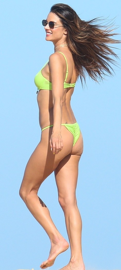 Alessandra Ambrosio rocking a skimpy light green bikini top with thin shoulder strap and a scoop neck