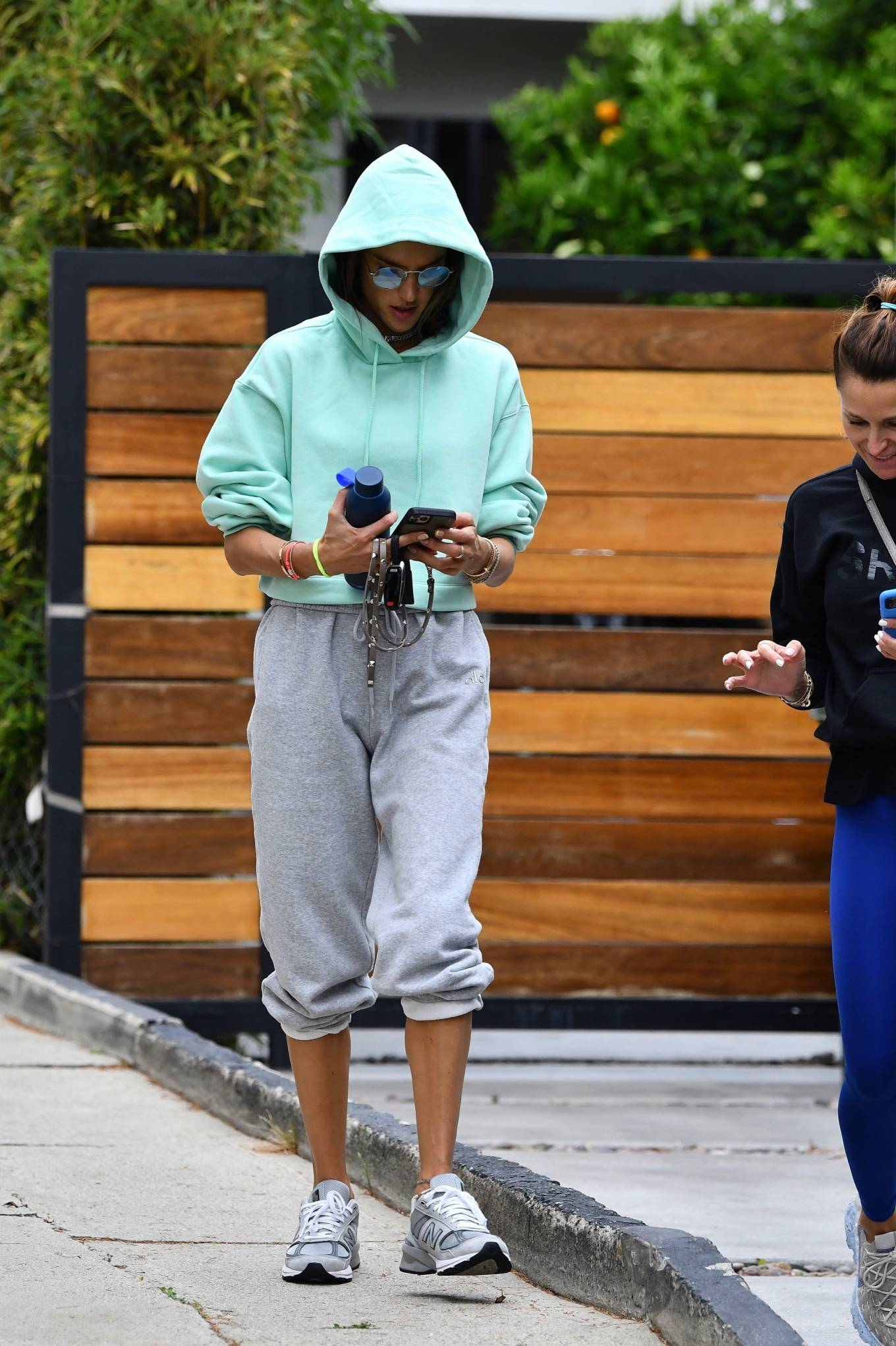 Alessandra Ambrosio donning brand logo grey leather lace-up sneakers by New Balance