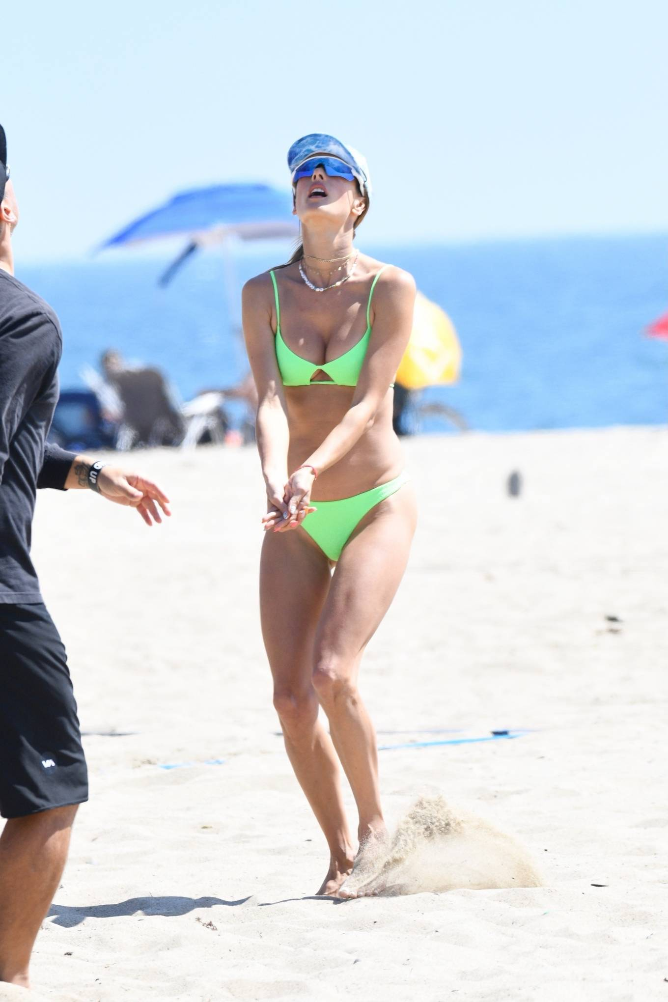 Alessandra Ambrosio wearing a skimpy light green bikini top with thin shoulder strap, cut outs, a scoop neck and spaghetti straps