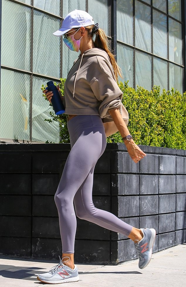 Alessandra Ambrosio rocking round rose gold light blue lace-up sneakers by New Balance with chunky sole