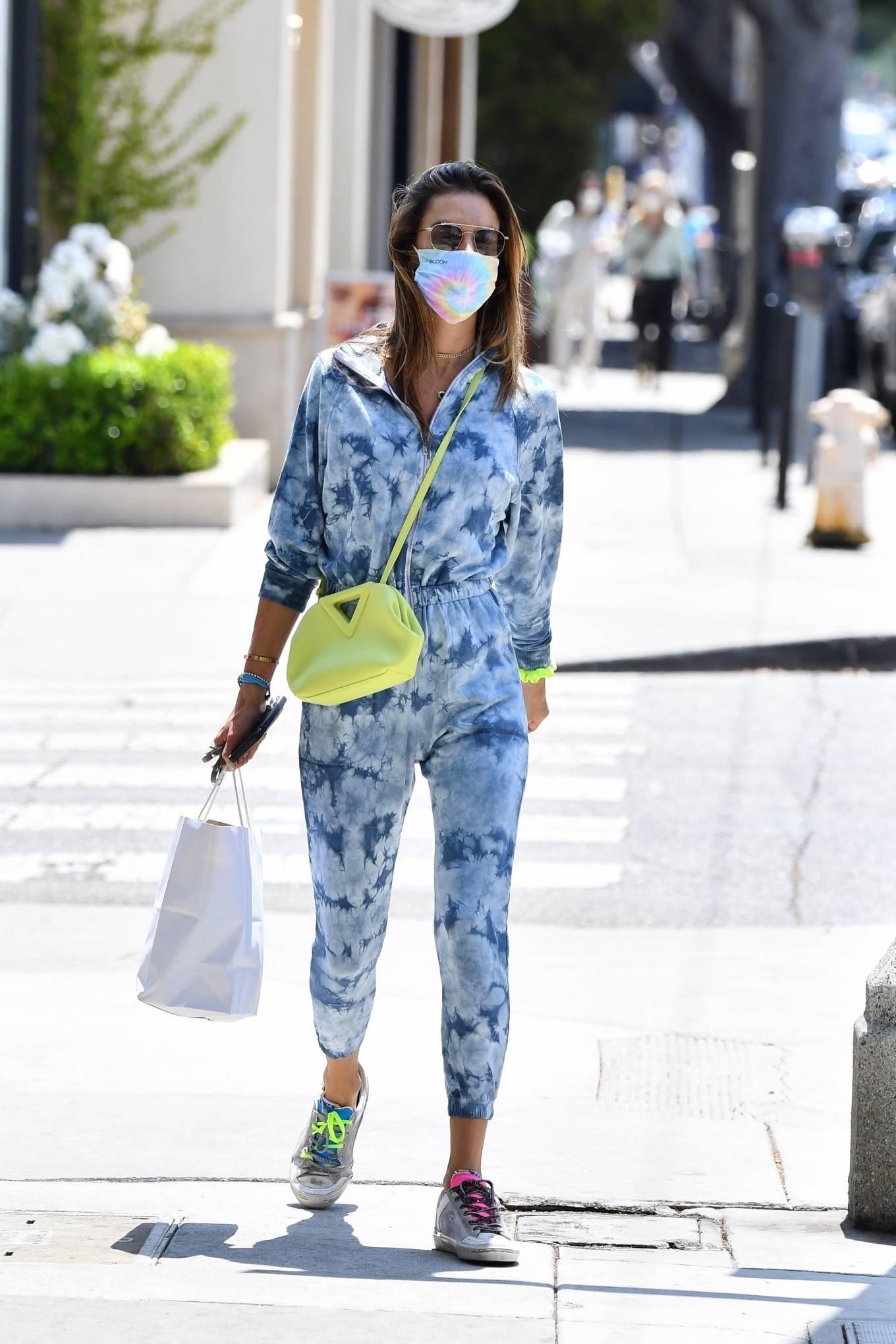 Alessandra Ambrosio rocking a comfortable blue jumpsuit with terry, full sleeves, elastic belt waist and elastic hem
