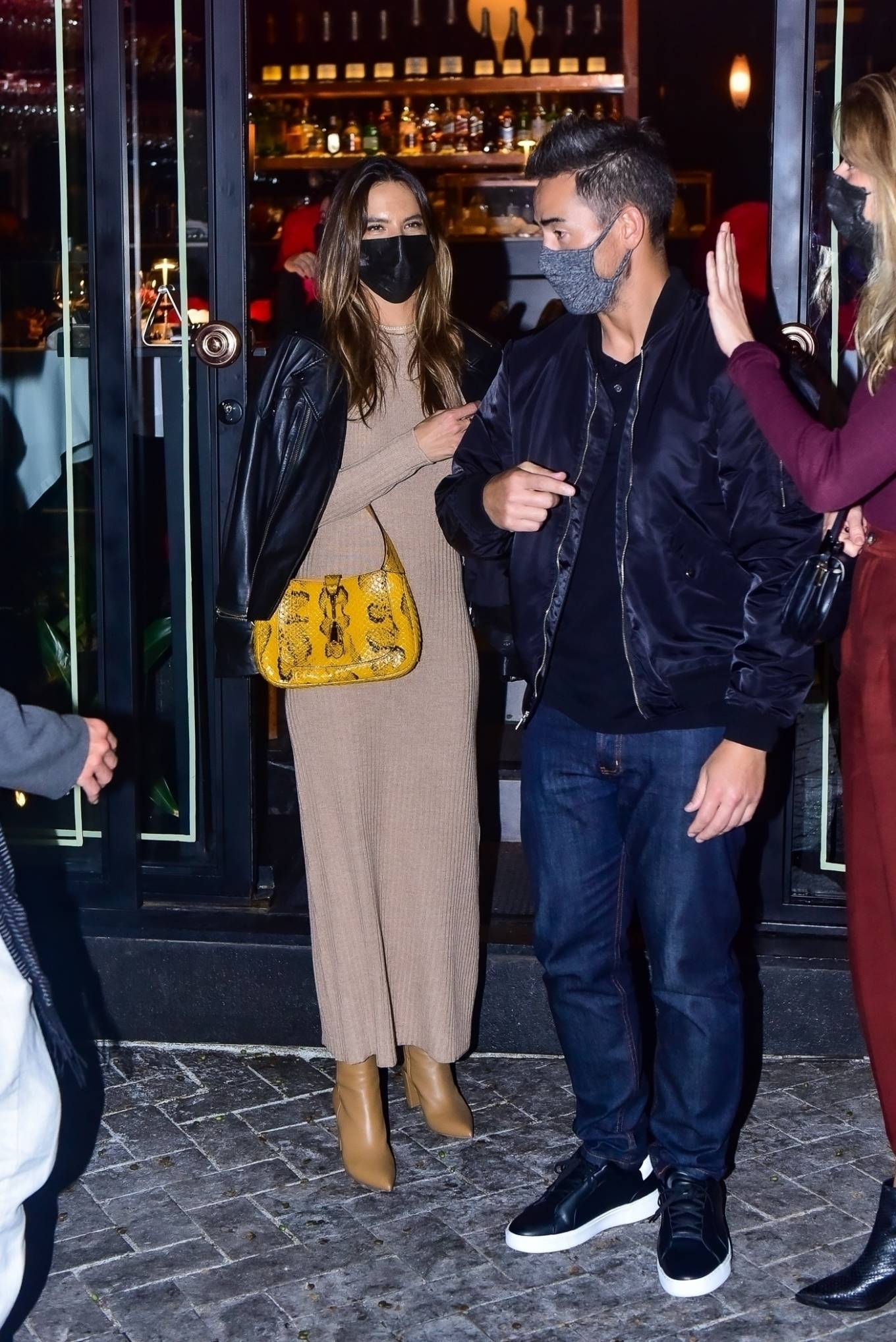 Alessandra Ambrosio wearing pointed mustard thigh high boots with cuban heel