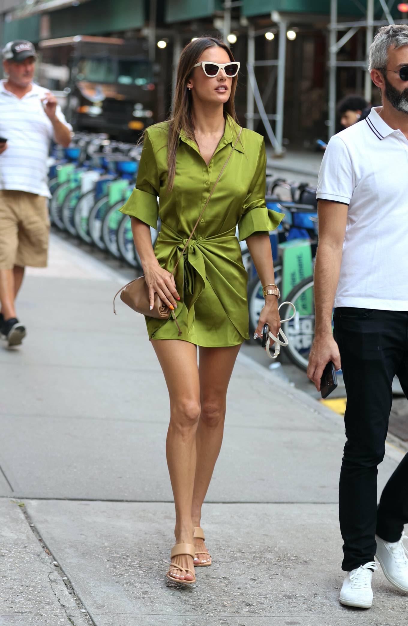 Alessandra Ambrosio rocking round beige slip on slide on sandal with high heel and wide strap