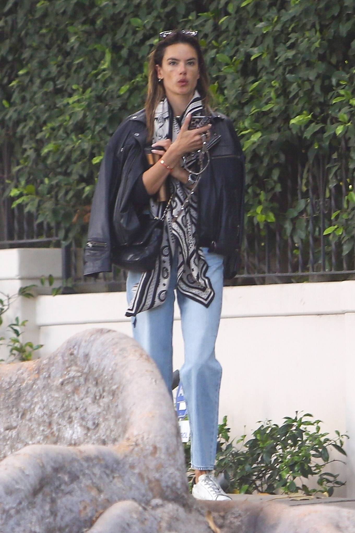 Alessandra Ambrosio donning embroidered white leather lace-up sneakers by Golden Goose Deluxe Brand with flat heel