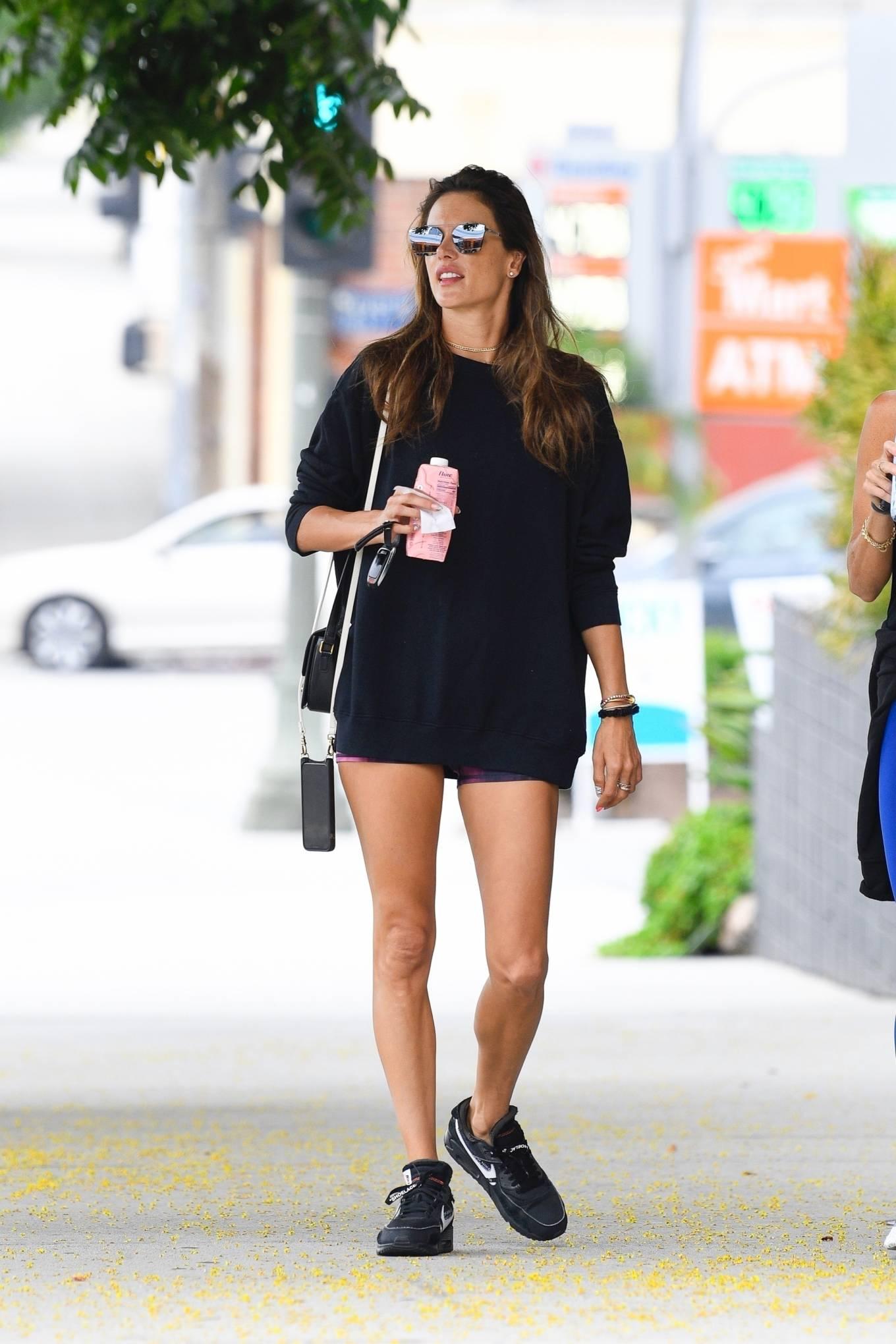 Alessandra Ambrosio rocking brand logo black Nike lace-up sneakers