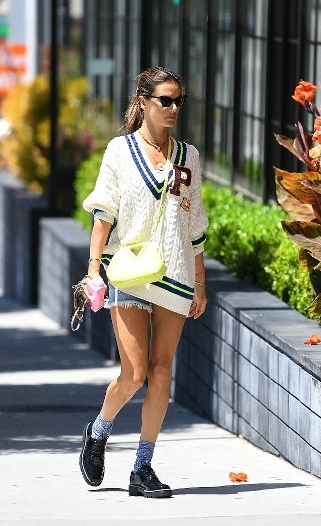 Alessandra Ambrosio donning fitted ripped shorts