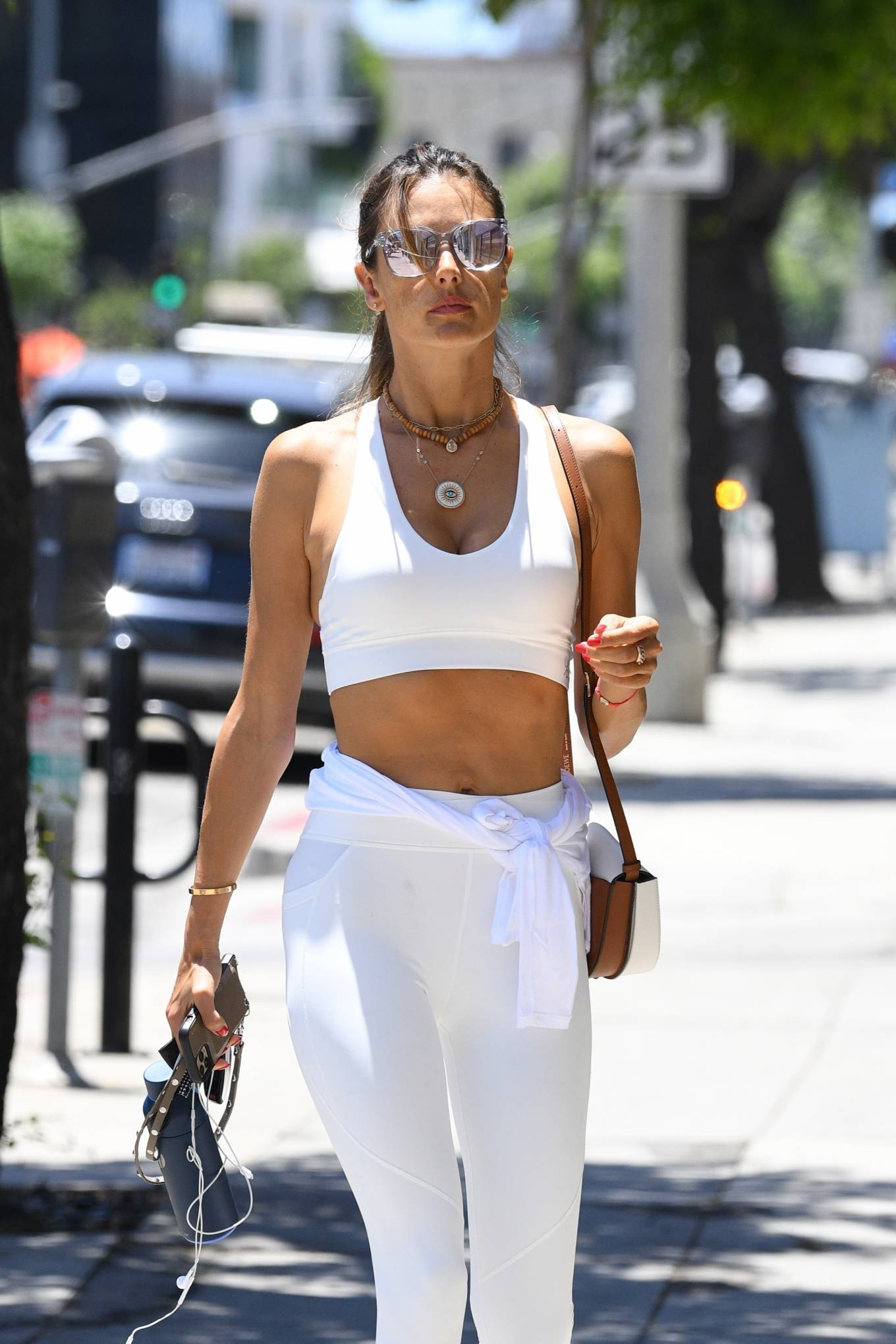 Alessandra Ambrosio wearing round white lace-up sneakers