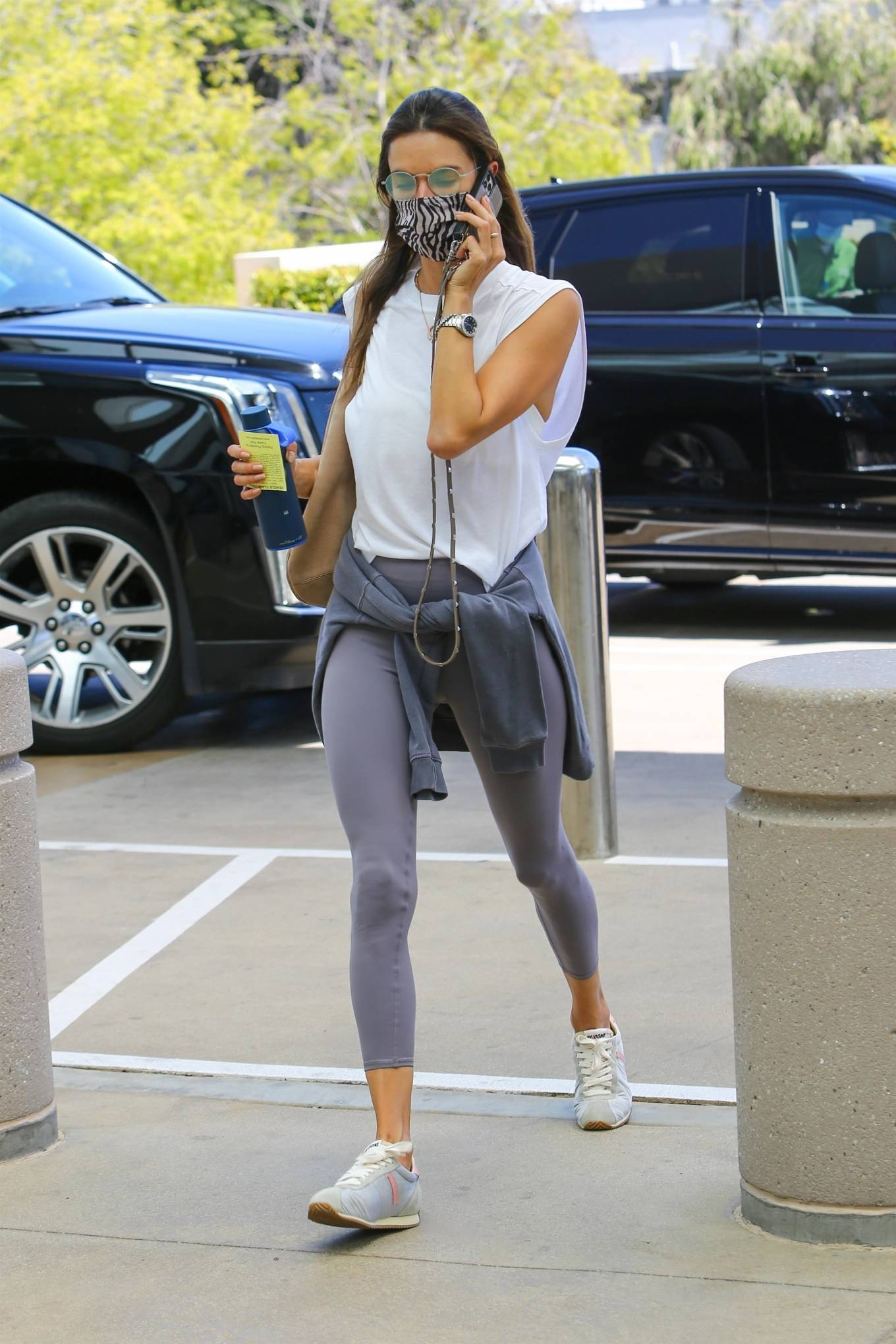 Alessandra Ambrosio wearing round lilac pink lace-up sneakers with flat heel