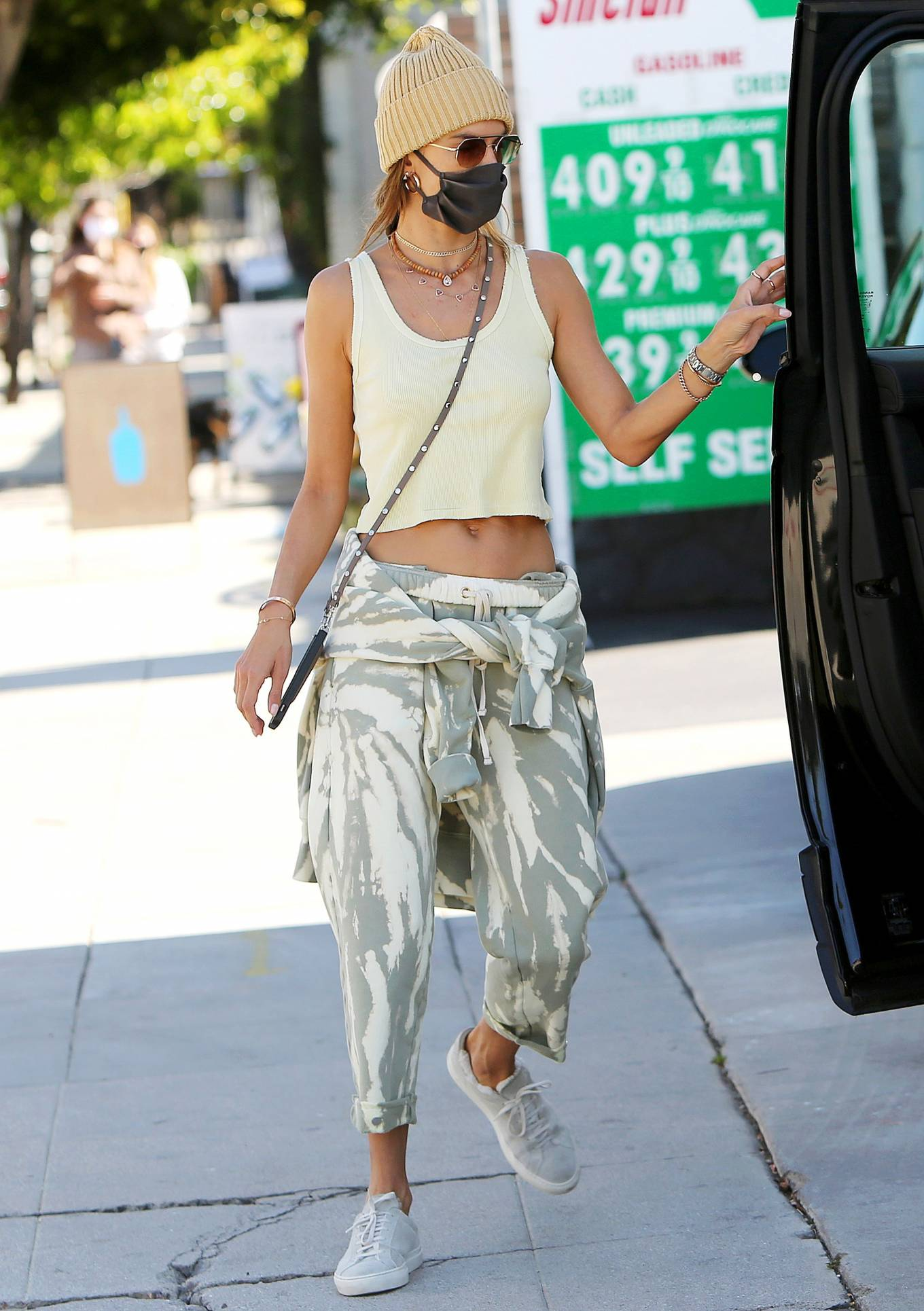 Alessandra Ambrosio rocking round grey suede lace-up sneakers by Common Projects with flat heel
