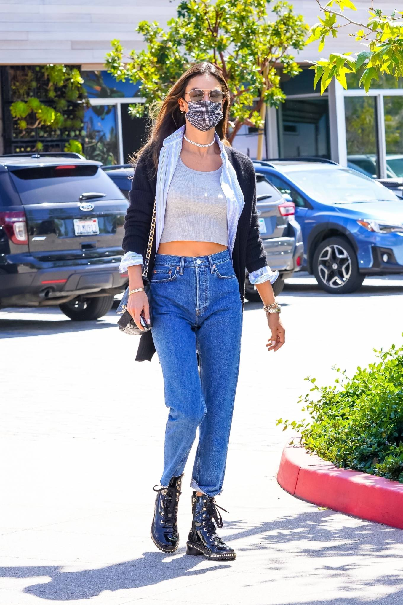 Alessandra Ambrosio wearing round black patent-leather ankle boots by Schutz with block heel
