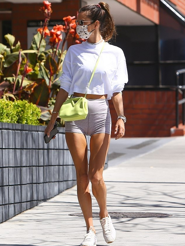 Alessandra Ambrosio donning round white lace-up sneakers