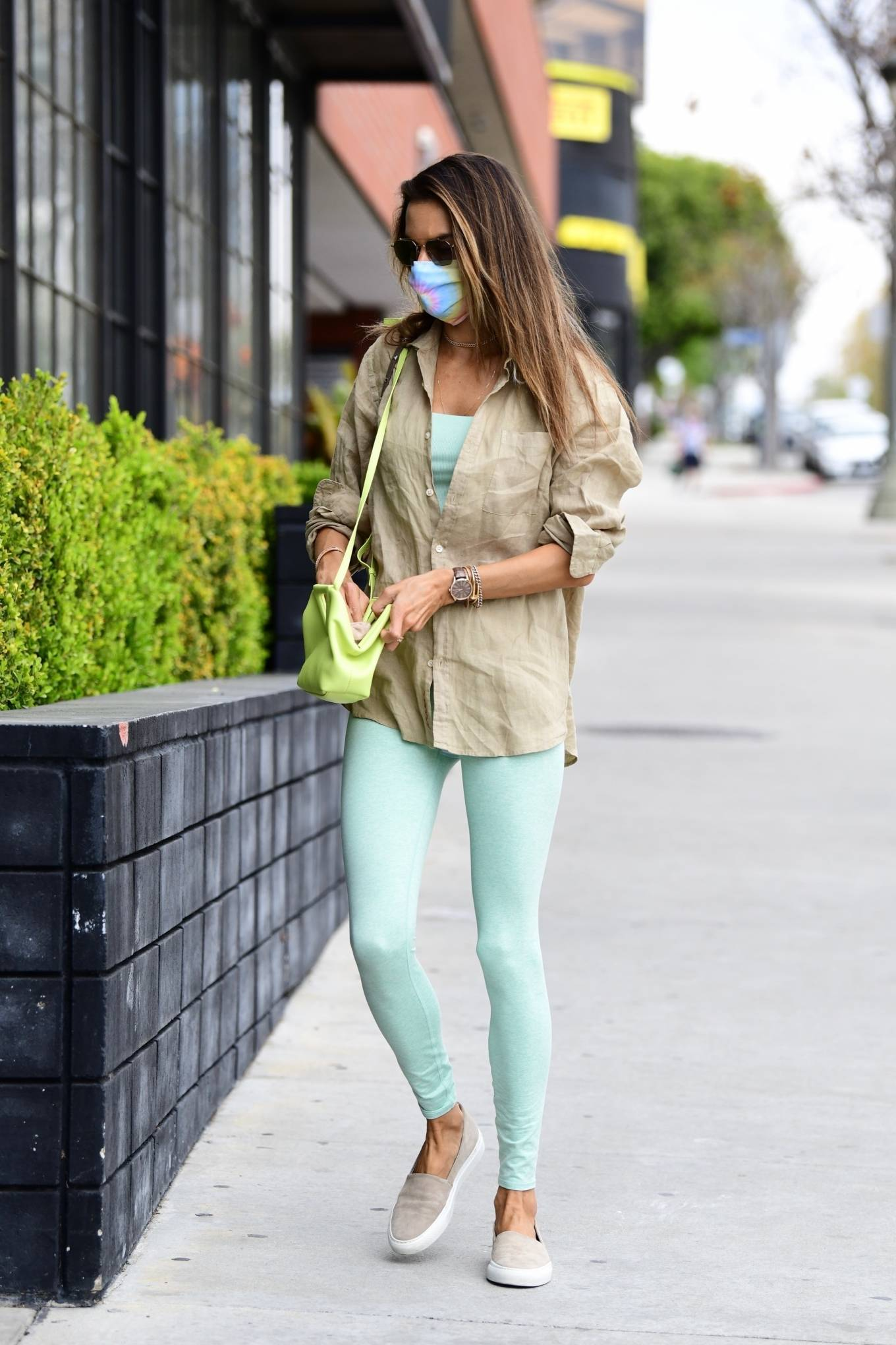 Alessandra Ambrosio wearing round grey Nude slip on loafers by Common Projects with flat heel