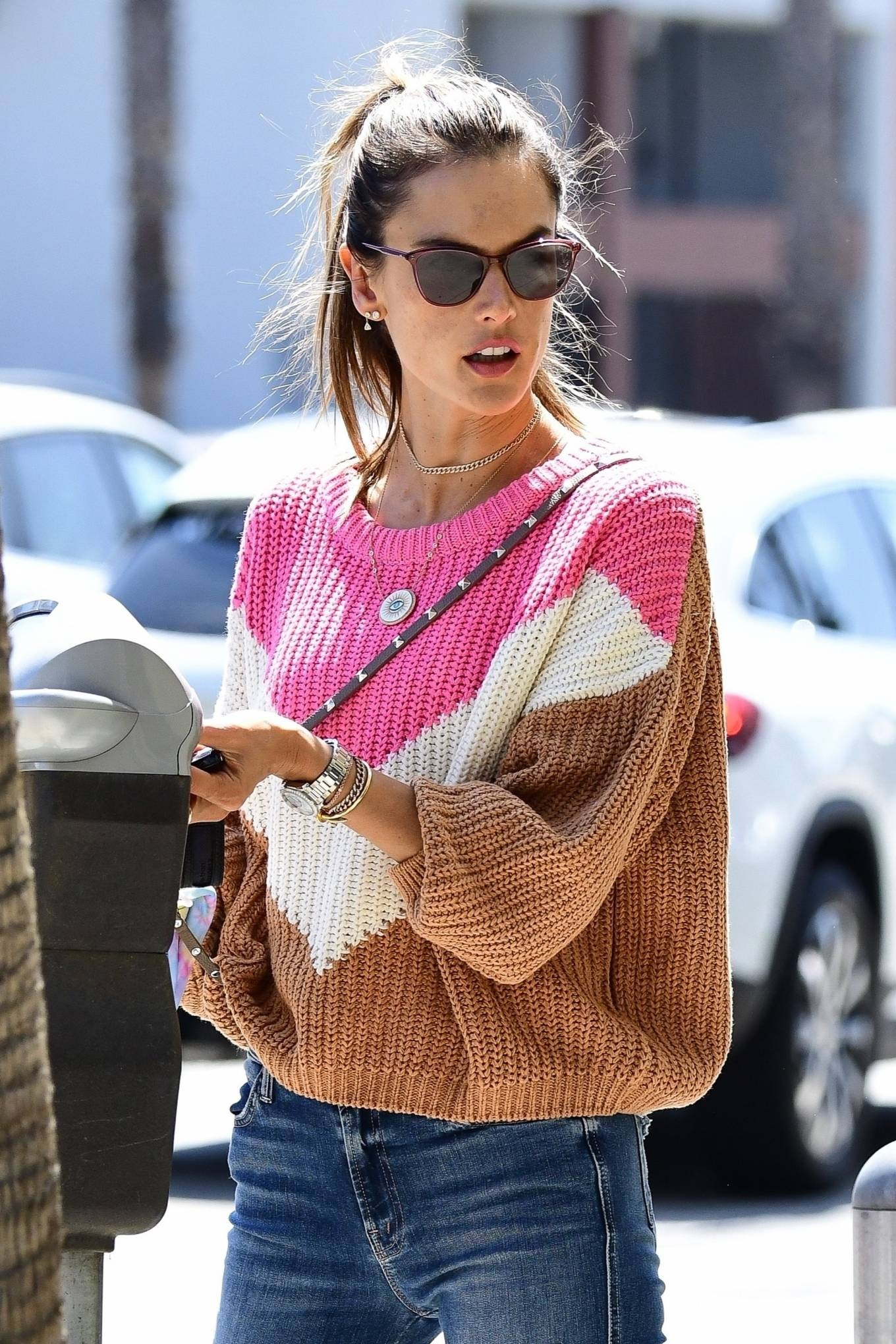 Alessandra Ambrosio, tan sneakers, oversized sweater, black sunglasses, round, lace-up, flat heel, brown sneakers, distressed blue jeans. Alessandra Ambrosio rocking round tan brown lace-up sneakers with flat heel