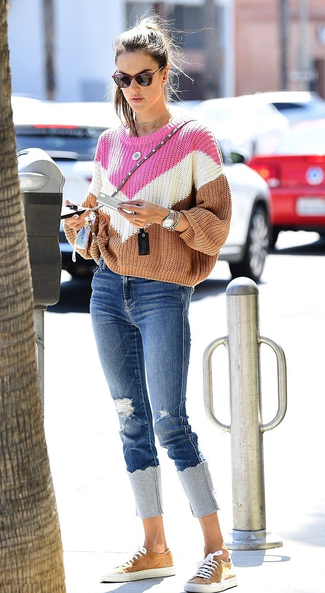 Alessandra Ambrosio rocking round tan brown lace-up sneakers with flat heel