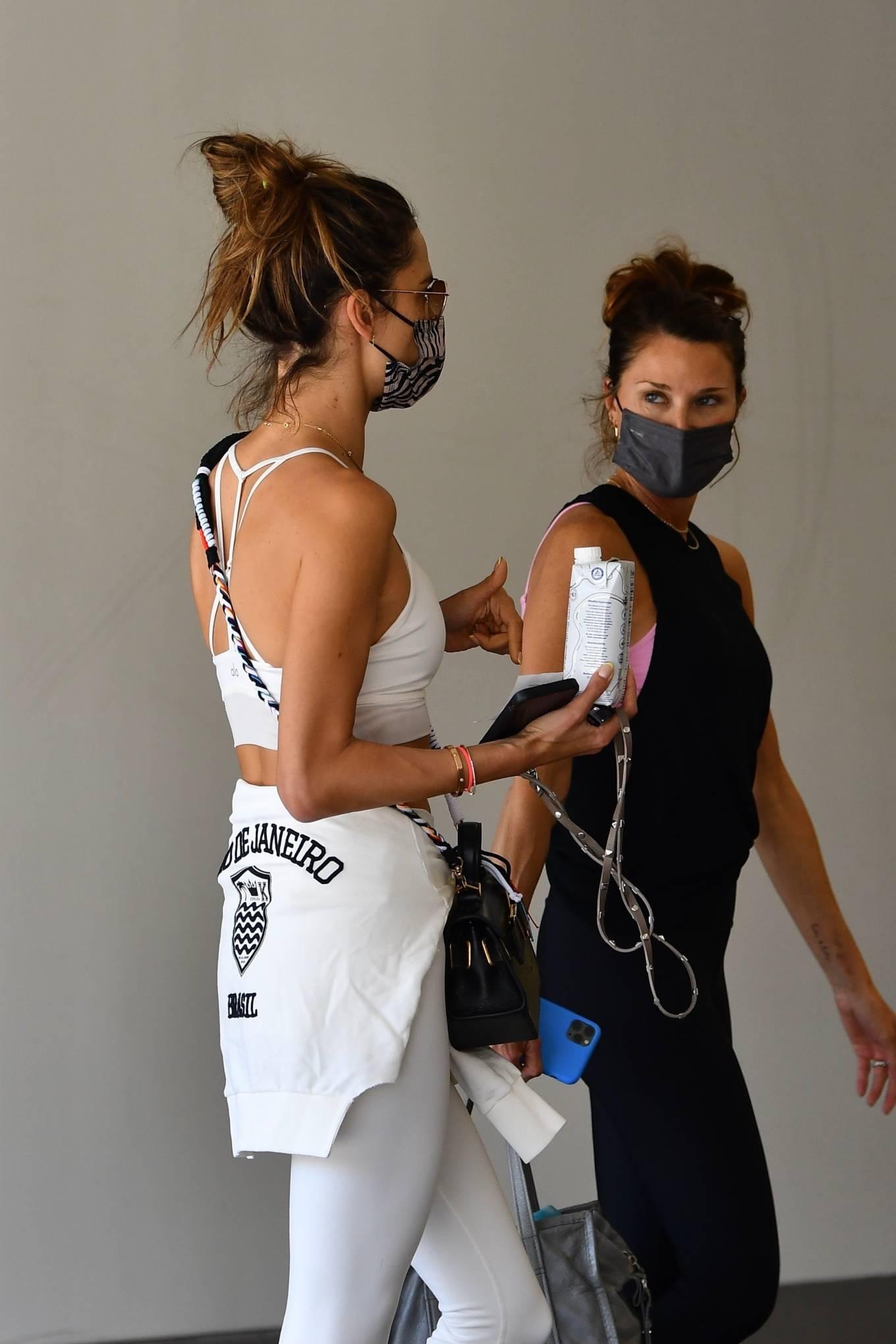 Alessandra Ambrosio rocking metal detailing white Saint Laurent slip on pumps