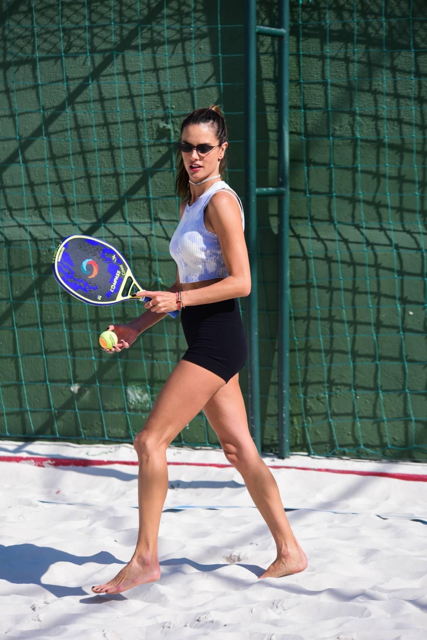 Alessandra Ambrosio wearing activewear black high waist shorts