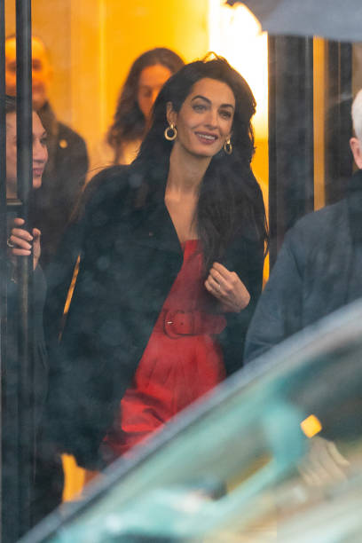 Amal Clooney donning pointy gold leather pumps by Gianvito Rossi with high heel