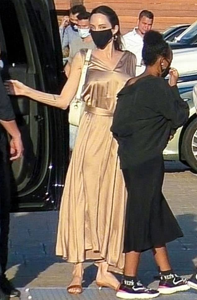 Angelina Jolie rocking tan brown open toe sandals with pointy heel