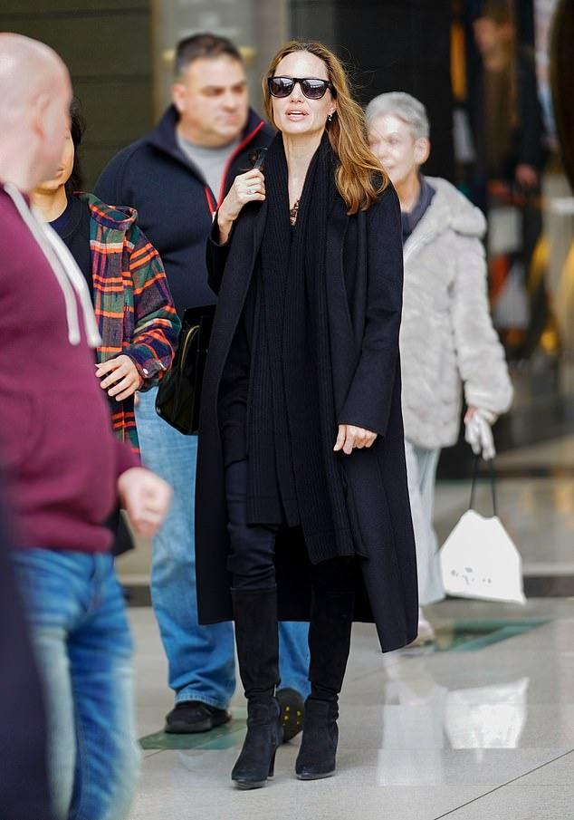 Angelina Jolie rocking narrow fit black denim jeans